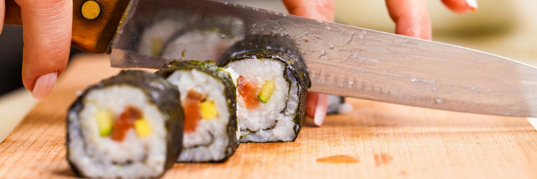 Cutting sushi rolls