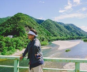 man in front of gonokawa river